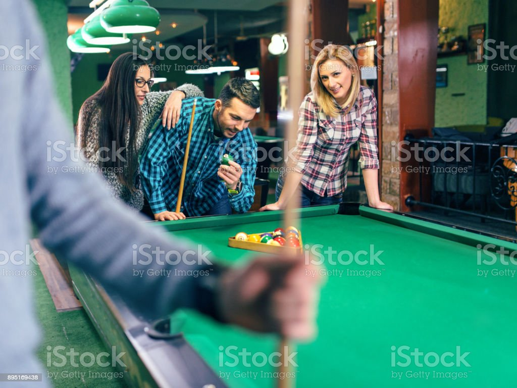 Freinds playing pool