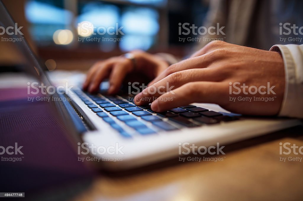 Close up of unrecognizable man working on computer. stock photo
