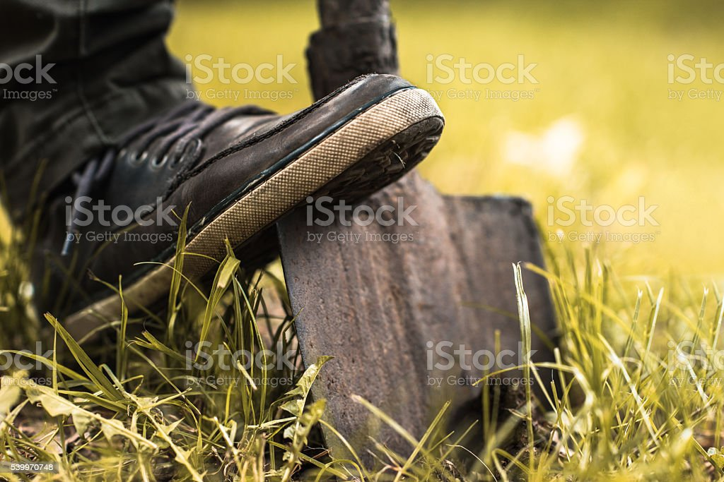 Close up of unrecognizable person digging with shovel. stock photo