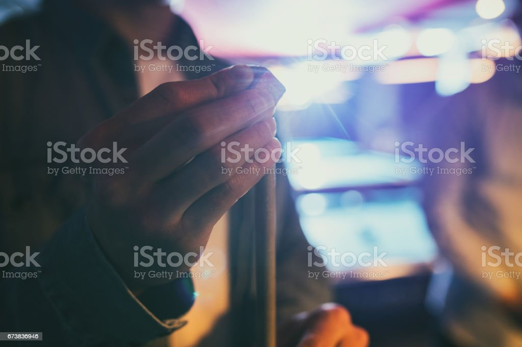 Close up of unrecognizable person rubbing a pool cue with a chalk. stock photo