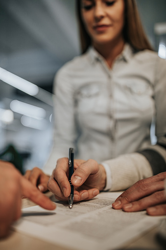 1072035844 istock photo Close up of unrecognizable person signing a legal document. 947163430
