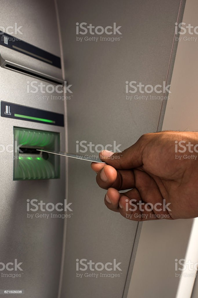 Close up of unrecognizable person with credit card on ATM. Lizenzfreies stock-foto