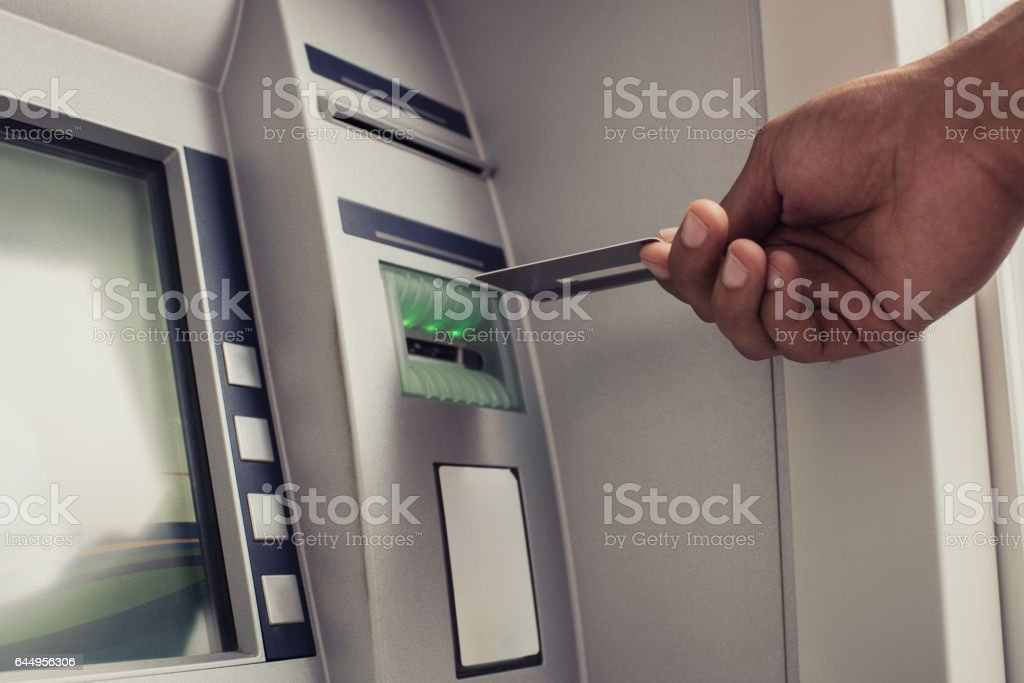 Close up of unrecognizable person with credit card on ATM. – zdjęcie