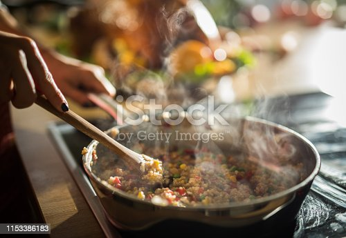 Close up of unrecognizable woman preparing healthy meal in frying pan.