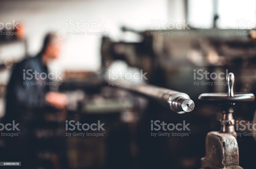 Close up of unrecognizable worker with stack of metal tubes stock photo