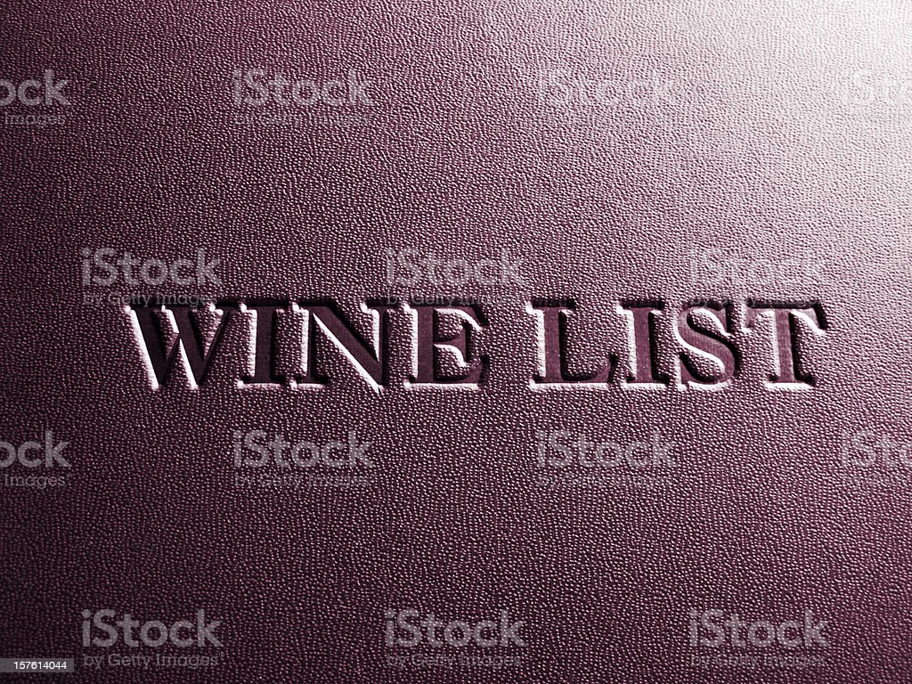 Close up of upmarket restaurant wine list cover stock photo