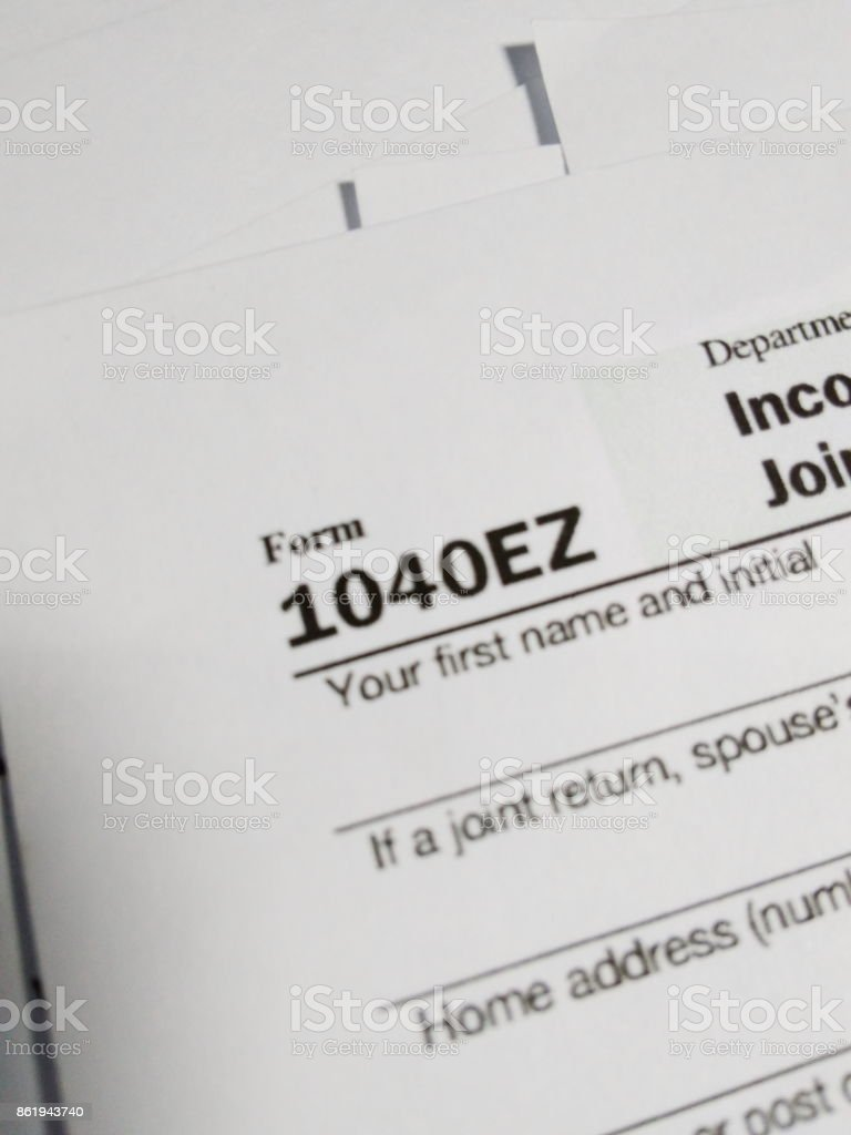Close Up of USA Tax Form type 1040ez, Income Tax Return for Single and Joint Filers With No Dependents stock photo