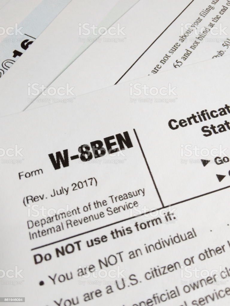 Close Up of USA Tax Form type W-8BEN, Certificate of Foreign Status of Beneficial Owner for United States Tax Withholding stock photo