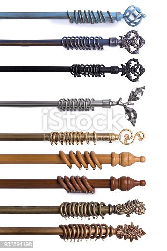 1058533662 istock photo Close Up Of Various Curtain Rods In Different Materials & Colors Isolated On White Background 932594198