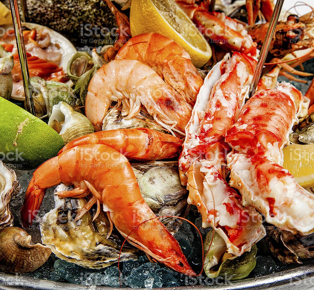 Close up of various shellfish dishes with lemons and limes stock photo