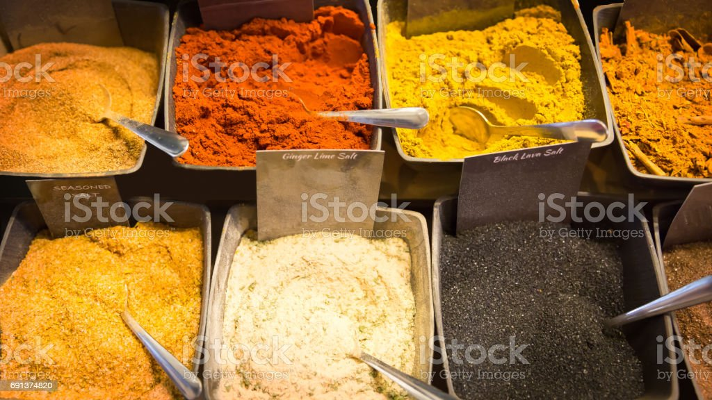 Close Up of Various Spices and Curry in bowls at Market stock photo
