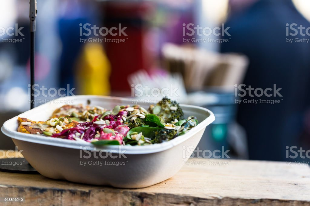 Close up of vegan vegetarian take away food for sale at Borough Market, London, UK stock photo
