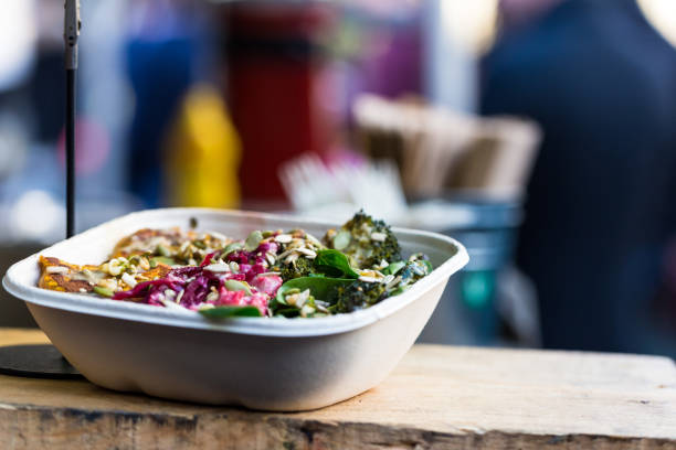 Close up of vegan vegetarian take away food for sale at Borough Market, London, UK stock photo