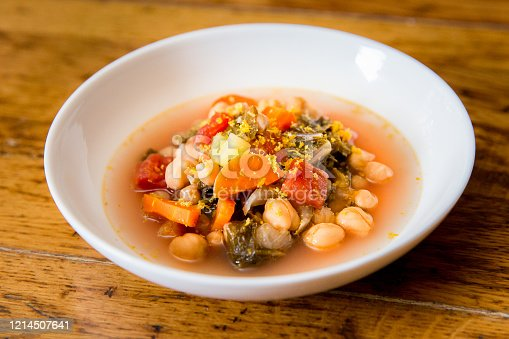 with kale, chickpeas, carrots, tomato, and lemon zest