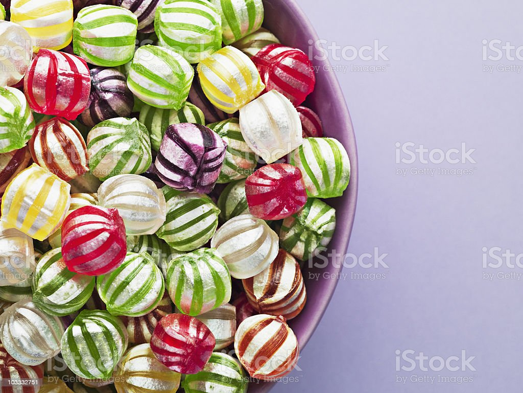 Close up of vibrant hard candy in bowl stock photo