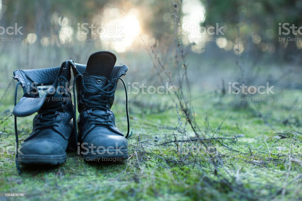 Close Up Of Vintage Pair Of Walking Boots On Boulder