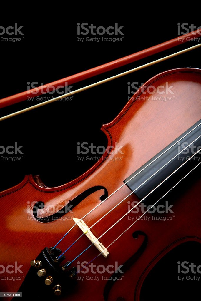 Close up of violin and bow on black background royalty-free stock photo