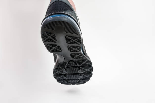 close up of walking shoes in low angle view on white background. stock photo