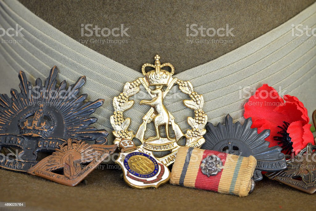 Close up of war medals resting against a slouch hat stock photo