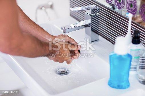 istock Close up of washing hands under running water 846326702