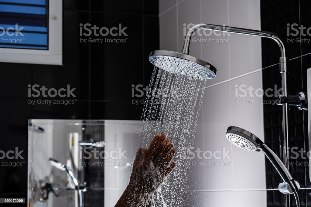 Close up of Water flowing from shower in the bathroom stock photo