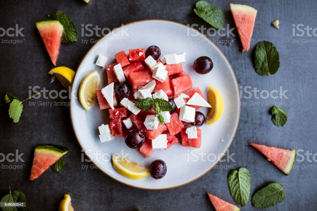 Close up of Watermelon salad with feta cheese, flat lay stock photo