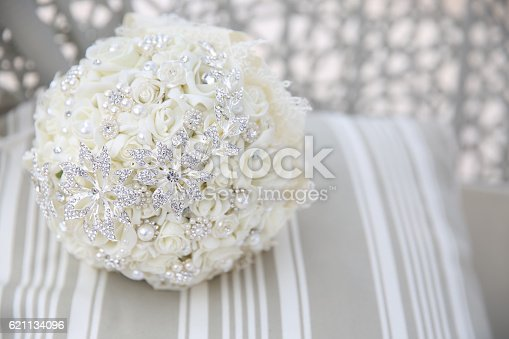istock close up of wedding bouquet with brooches 621134096