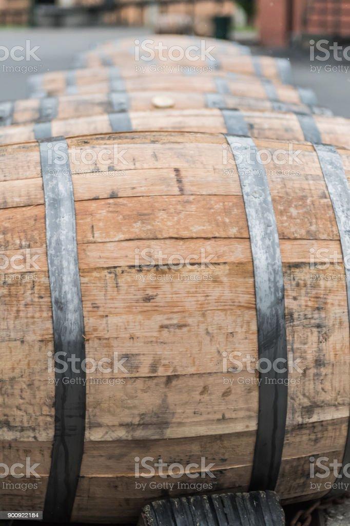 Close Up of Wet Bourbon Barrel in the Rain stock photo