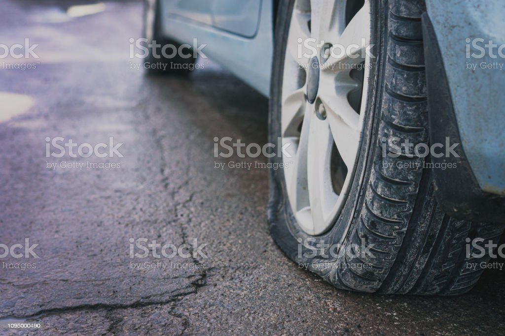Close up of wheel of car tire leak from puncture. Rear view. stock photo