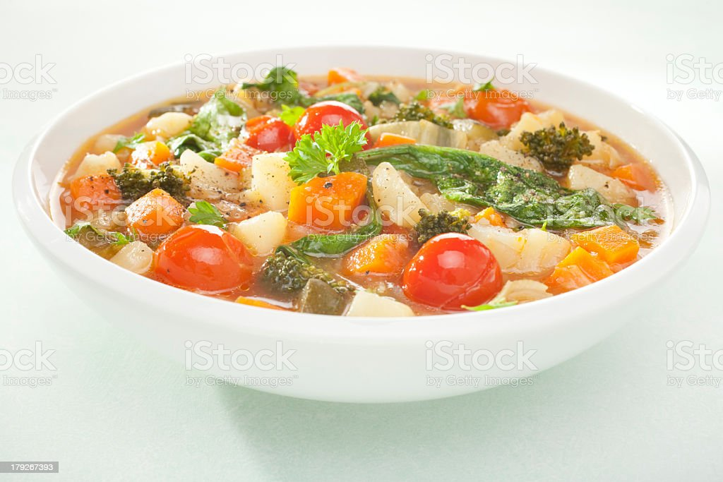 Close up of white bowl of vegetable soup stock photo
