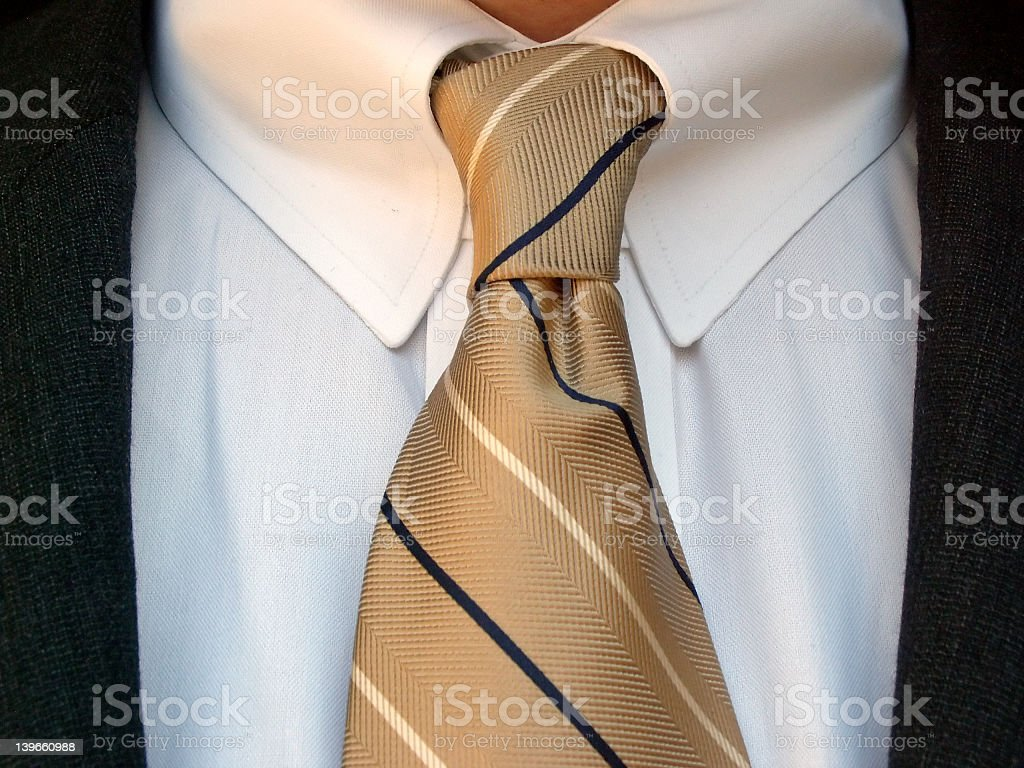 3328b8bc35c3ce Close Up Of White Shirt And Brown Tie Stock Photo & More Pictures of ...