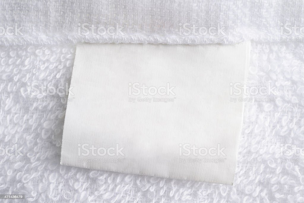 Close up of white towel with blank label stock photo