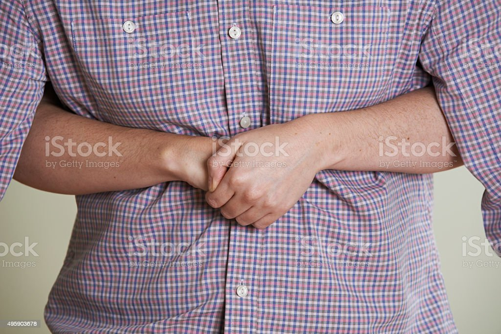 Close Up Of Woman Demonstrating Heimlich Maneuver stock photo