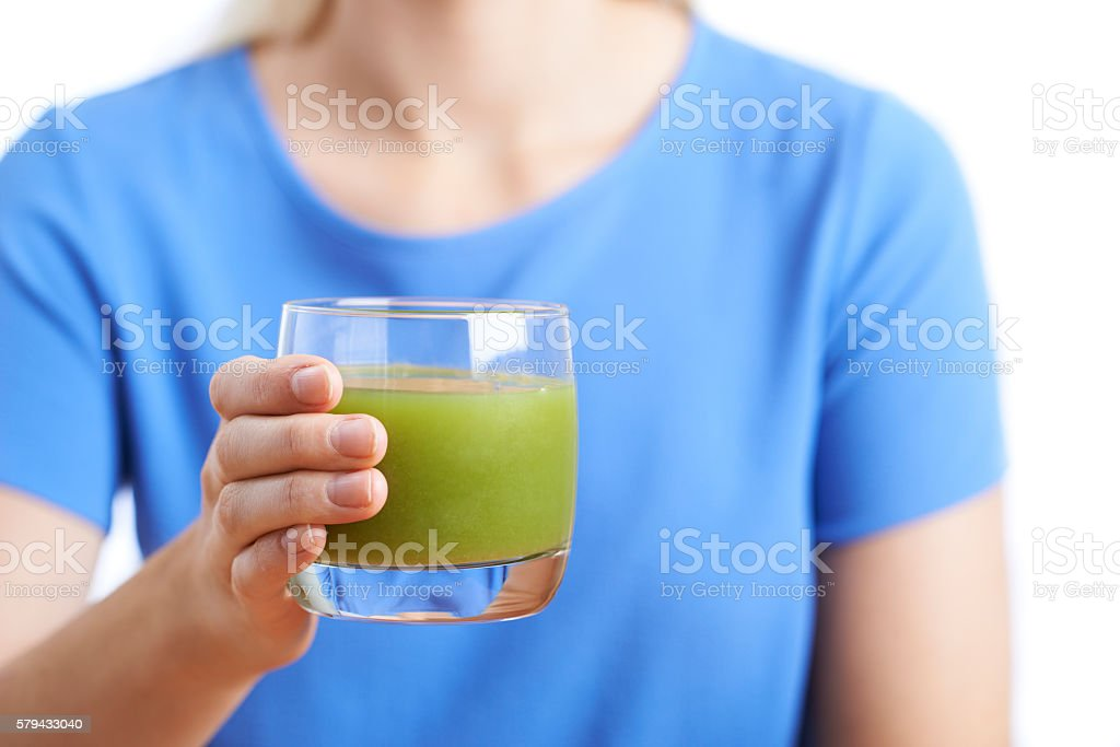 Close Up Of Woman Drinking Glass Of Healthy Vegetable Juice stock photo