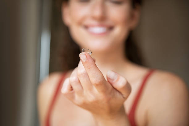 Close up of woman finger showing contact lens stock photo
