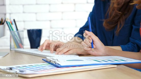 905049450 istock photo Close up of woman hand working on paperwork at home office, Young student taking note for online education 1190087015