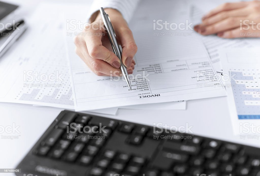 close up of woman hands filling tax paper stock photo