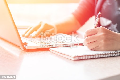 istock Close Up of woman hands using mobile phone 599882308