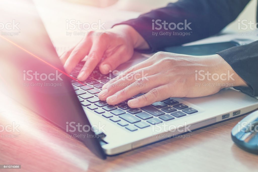 Close Up of woman hands using mobile phone stock photo