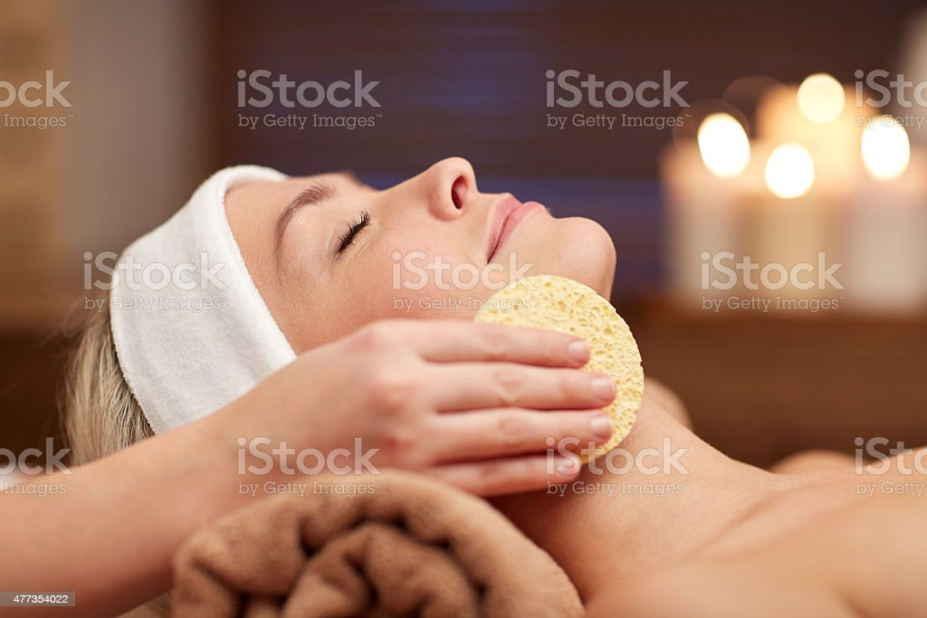 close up of woman having face cleaning in spa stock photo