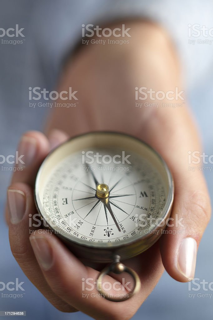 Close up of woman holding a directional compass stock photo
