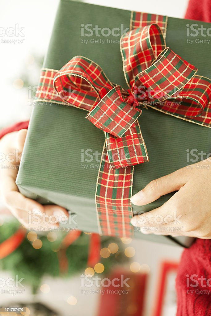 close up of woman holding Christmas present royalty-free stock photo