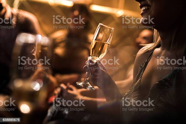 Close up of woman holding glass of champagne in nightclub picture id638885676?b=1&k=6&m=638885676&s=612x612&h=sq0cb2 67brgexse0me8l6lq8ucw3llvdfas8vub7lw=