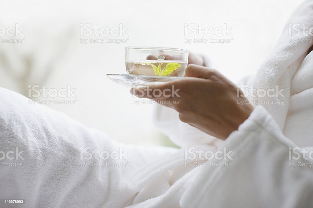 Close up of woman holding water stock photo