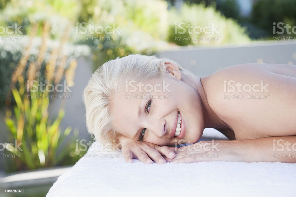 Close up of woman laying in massage table royalty-free stock photo
