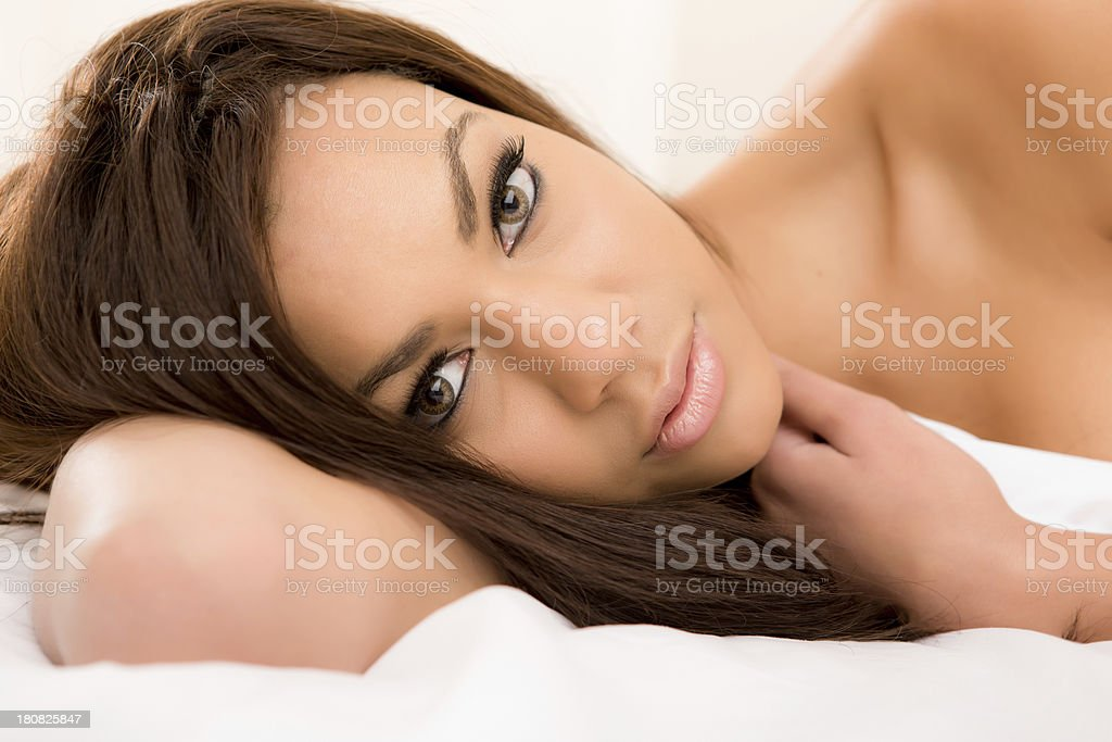 Close up of woman laying on bed royalty-free stock photo