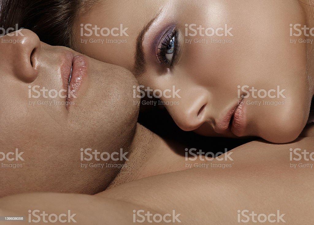 close up of woman laying on husband stock photo