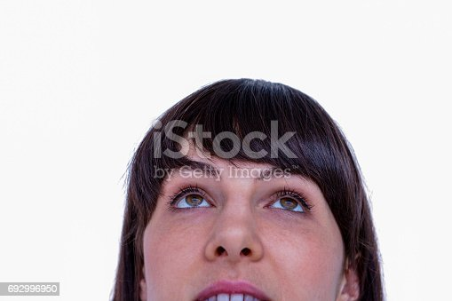 Close up of woman looking up on white background