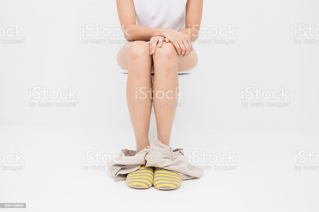 Close up of woman on toilet stock photo