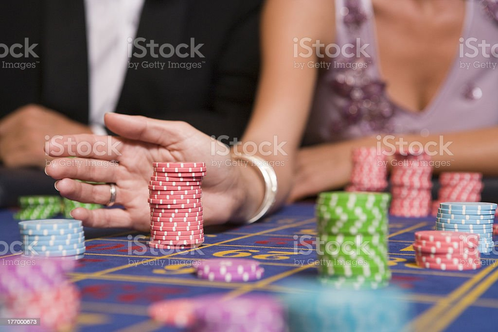 Close up of woman placing bet on roulette table royalty-free stock photo